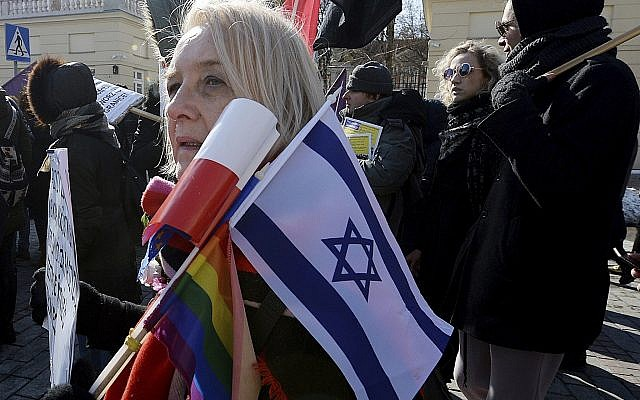Warsaw residents protests the rise of racism and anti-Semitism in Warsaw, Poland, Saturday, March 17, 2018. Similar protests were held in some other cities across Poland. (AP Photo/Czarek Sokolowski)