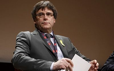 "In this file photo from March 18, 2018, Catalan's fugitive ex-president Carles Puigdemont, takes part in a panel titled ""Self-Determination,"" at the International Film Festival and Forum on Human Rights, in Geneva, Switzerland. (Salvatore Di Nolfi/Keystone via AP, file)"
