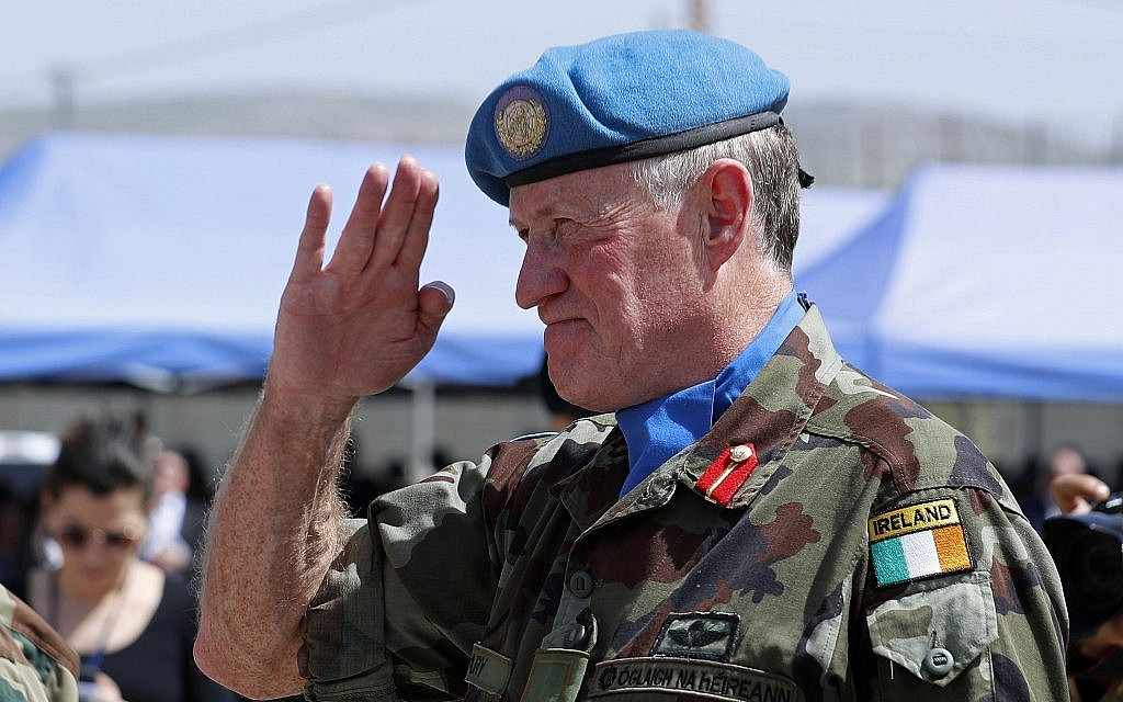 Head of Mission and Force Commander of the United Nations Interim Force in Lebanon (UNIFIL), Maj. Gen. Michael Beary of Ireland, reviews an honor guard of United Nations peacekeepers during a ceremony to mark the 40th anniversary of UNIFIL's peacekeeping presence in southern Lebanon, in the coastal town of Naqoura, Lebanon, March 19, 2018. (AP Photo/Hassan Ammar)