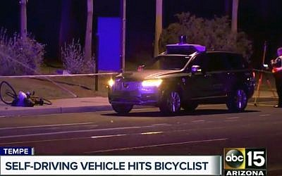 This March 19, 2018, still image taken from video provided by ABC-15, shows investigators at the scene of a fatal accident involving a self-driving Uber car on the street in Tempe, Arizona. (ABC-15.com via AP)