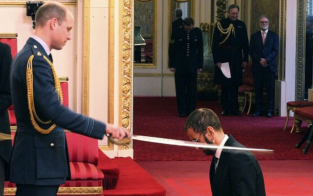 Former Beatle Ringo Starr, is made a knight by Britain's Prince William at Buckingham Palace during an Investiture ceremony in London Tuesday March 20, 2018. (Yui Mok/PA via AP)