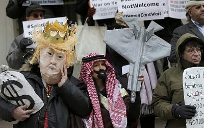 Protesters, some dressed as United States President Donald Trump and Crown Prince Mohammed bin Salman, stand on the steps of City Hall in New York, March 20, 2018. (AP Photo/Seth Wenig)