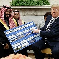 US President Donald Trump shows a chart highlighting arms sales to Saudi Arabia during a meeting with Saudi Crown Prince Mohammed bin Salman in the Oval Office of the White House, March 20, 2018, in Washington. (AP Photo/Evan Vucci)