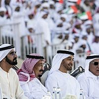 In this December 4, 2016 file photo, released by Emirates News Agency, WAM, Saudi King Salman, second left, attends the Sheikh Zayed Heritage Festival while seated next to Sheikh Mohammed bin Rashid Al Maktoum, UAE prime minister and ruler, left, and Sheikh Mohamed bin Zayed Al Nahyan, Crown Prince of Abu Dhabi, second right, in Abu Dhabi, United Arab Emirates. (Emirates News Agency via AP)