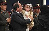 In this March 15, 2018 photo provided by Egypt's state news agency, MENA,Egyptian President Abdel-Fattah el-Sissi holds a child at an education seminar in Cairo, Egypt. (MENA via AP)