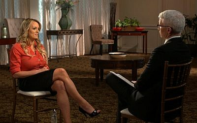 This image released by CBS News shows Stormy Daniels, left, during an interview with Anderson Cooper which aired on March 25, 2018, on '60 Minutes.' (CBS News/60 Minutes via AP)