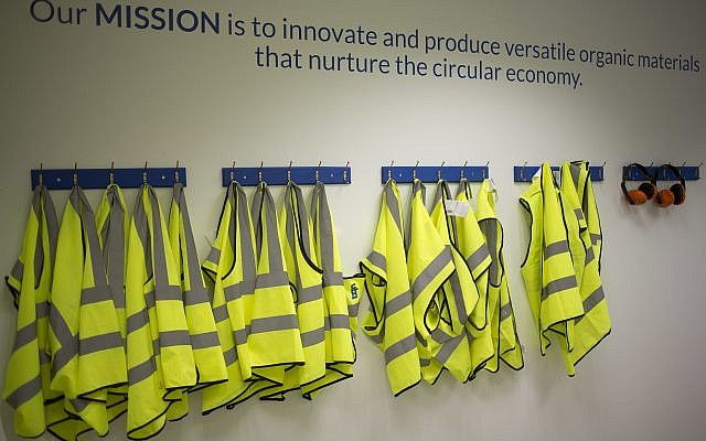 In this Tuesday, March 13, 2018 photo, safety jackets hang at the UBQ factory in Kibbutz Tzeelim. (AP Photo/Ariel Schalit)