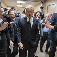 Sen. Rand Paul, walks to the Senate floor for a vote with accompanying reporters, on Capitol Hill in Washington on March 21, 2018.  (AP/J. Scott Applewhite)