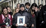 Ilan Alhadeff, joined at left by his wife Lori Alhadeff, holds a photograph of their daughter, Alyssa Alhadeff, 14, who was killed at Marjory Stoneman Douglas High School in Parkland, Fla., during a rally by lawmakers and student activists in support of gun control at the U.S. Capitol in Washington, Friday, March 23, 2018, a day before the March for Our Lives event. (AP Photo/J. Scott Applewhite)
