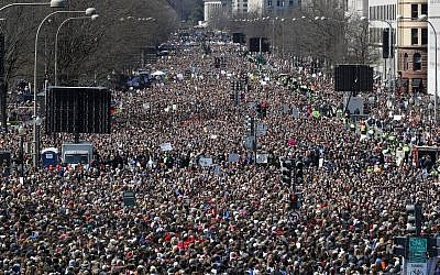 Looking west from the stage area, the crowd fills Pennsylvania Avenue during the 'March for Our Lives' rally in support of gun control, Saturday, March 24, 2018, in Washington. (AP Photo/Alex Brandon)