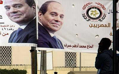Banners showing Egyptian President Abdel-Fattah el-Sissi hang in Tahrir Square, March 22, 2018. (AP Photo/Amr Nabil)