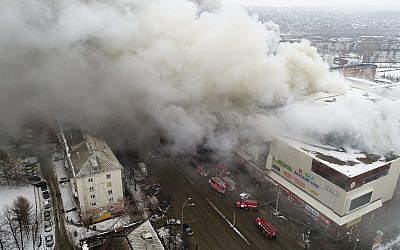 In this Russian Emergency Situations Ministry photo, on Sunday, March 25, 2018, smoke rises above a multi-story shopping center in the Siberian city of Kemerovo, about 3,000 kilometers (1,900 miles) east of Moscow, Russia. (Russian Ministry for Emergency Situations photo via AP)