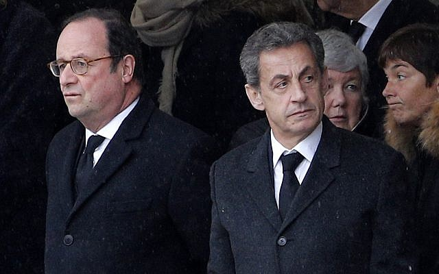 Former French Presidents Francois Hollande, left, and Nicolas Sarkozy wait prior to a national ceremony for Lt. Col. Arnaud Beltrame, Wednesday March 28, 2018 at the Hotel des Invalides in Paris. (AP Photo/Christophe Ena)
