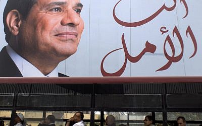 "People travel on a public bus under an election banner for Egyptian President Abdel-Fattah el-Sissi with Arabic that reads, ""you are the hope,"" in Cairo, Egypt, March 28, 2018. (AP Photo/Amr Nabil)"