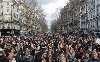 People attend a silent march to honor an 85-year-old woman who escaped the Nazis 76 years ago but was stabbed to death last week in her Paris apartment, apparently targeted because she was Jewish, and to denounce racism, in Paris, France, March 28, 2018. (AP Photo/Thibault Camus)