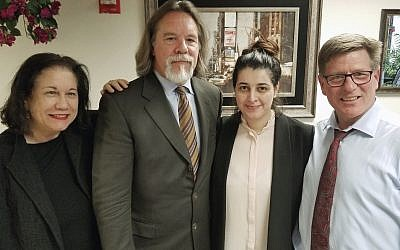 In this Friday, March 30, 2018 photo, Noor Salman, second from right, and her attorneys pose for a photo after Salman was acquitted of lying to the FBI and helping her husband attack the Pulse nightclub in Orlando, Fla. The attorneys, Linda Moreno, Fritz Scheller, Charles Swift pose with Salman from left. (Susan Clary via AP)