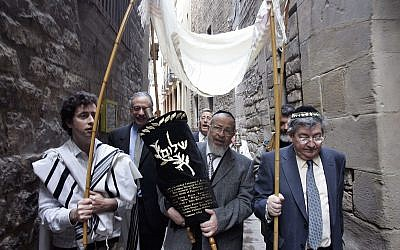 Illustrative: Members of the restored Synagogue of Barcelona carry the holy Torah to their new home in Barcelona, Spain, Sunday, Jan. 22, 2006. (AP Photo/Manu Fernandez)
