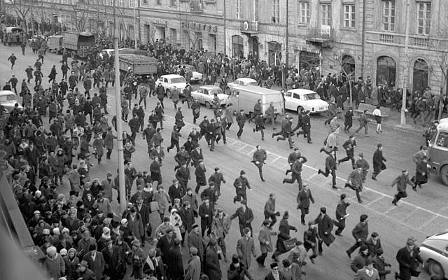 A March 1968 black and white photo showing people running away as police attack near the Warsaw University during student riots. The 1968 student riots in Poland ended with an anti-Semitic campaign by the communist regime that drove an estimated 15,000 Jews from Poland. (AP Photo/PAP/CAF-Tadeusz Zagozdzinski, file)