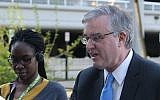 David Trone, right, owner of wine superstore chain Total Wine and More, greets commuters at the Shady Grove Metro station, in Derwood, Md., on Wednesday, April 20, 2016. (AP Photo/Brian Witte)