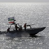 In this Monday, July 2, 2012 file photo, an Iranian Revolutionary Guard speedboat escorts a passenger ship, unseen, near the spot where an Iranian airliner was shot down by a U.S. warship 24 years ago killing 290 passengers. (AP/Vahid Salemi, File)