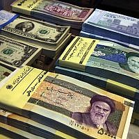 Iranian and US banknotes on display at a currency exchange shop in downtown Tehran, Iran, on April 4, 2015. (Vahid Salemi/AP)