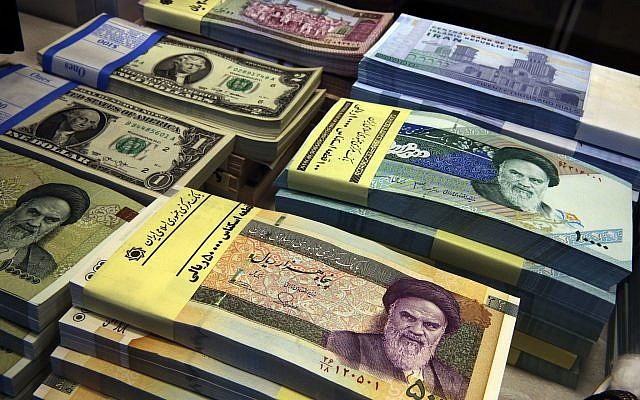 Iranian and US banknotes on display at a currency exchange shop in downtown  Tehran, Iran
