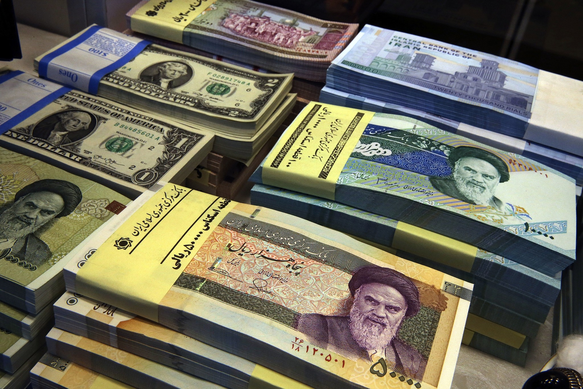 Iranian And Us Banknotes On Display At A Currency Exchange In Downtown Tehran Iran