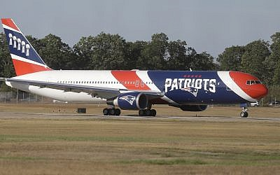 The New England Patriots customized Boeing 767 passenger jet taxis at T.F. Green Airport, in Warwick, Rhode Island, October 4, 2017. (AP Photo/Steven Senne)