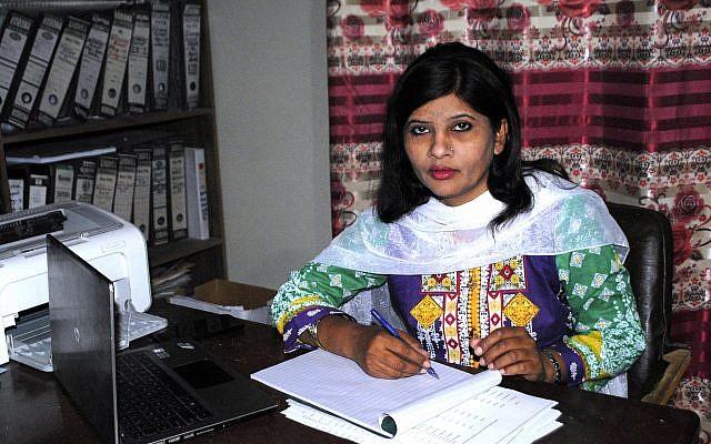 Krishna Kumari, from the Pakistani Hindu minority, works in her office in Hyderabad, Pakistan, February 12, 2018. (AP Photo/Pervez Masih)