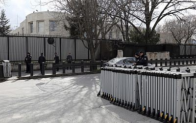 Turkish security members stand outside the US embassy in Ankara, Turkey, Monday, March 5, 2018. (AP Photo/Burhan Ozbilici)