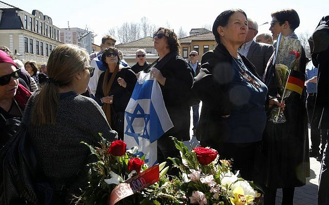People gather to take part in the International March of the Living, through downtown Bitola, southern Macedonia, to commemorate the victims of the Holocaust, on March 11, 2018. (AP Photo/Boris Grdanoski)