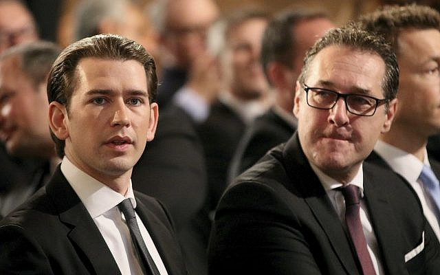 Austrian Chancellor Sebastian Kurz and Vice Chancellor Heinz-Christian Strache, from left, wait for the start of a commemoration on the occasion of the 80th anniversary of the connection to Hitler Germany, the so-called Anschluss, at the Hofburg palace in Vienna, Austria, Monday, March 12, 2018. (AP Photo/Ronald Zak)