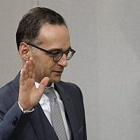 German Foreign Minister Heiko Maas takes the oath of office after the new government was appointed after German Chancellor Angela Merkel was elected for a fourth term as chancellor in the German parliament Bundestag in Berlin, Germany, Wednesday, March 14, 2018. (AP Photo/Michael Sohn)
