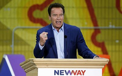 Former California Gov. Arnold Schwarzenegger speaks at the first New Way California Summit, a political committee eager to reshape the state GOP, at the Hollenbeck Youth Center in Los Angeles, Wednesday, March 21, 2018. (AP Photo/Damian Dovarganes)