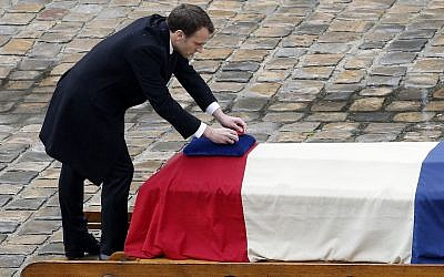 French President Emmanuel Macron posthumously awards the Legion of Honor to Lt. Col. Arnaud Beltrame during a ceremony Wednesday March 28, 2018 at the Hotel des Invalides in Paris. (AP Photo/Christophe Ena)