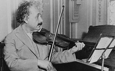 Albert Einstein is shown playing the violin, date and location unknown (AP Photo)