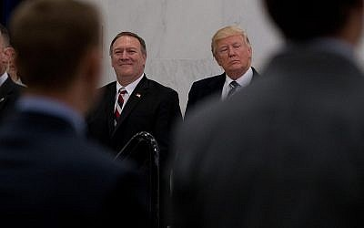 US President Donald Trump, accompanied by CIA Director-designate Rep. Michael Pompeo, left, waits to speak at the Central Intelligence Agency in Langley, Virginia, Saturday, January 21, 2017. (AP Photo/Andrew Harnik)