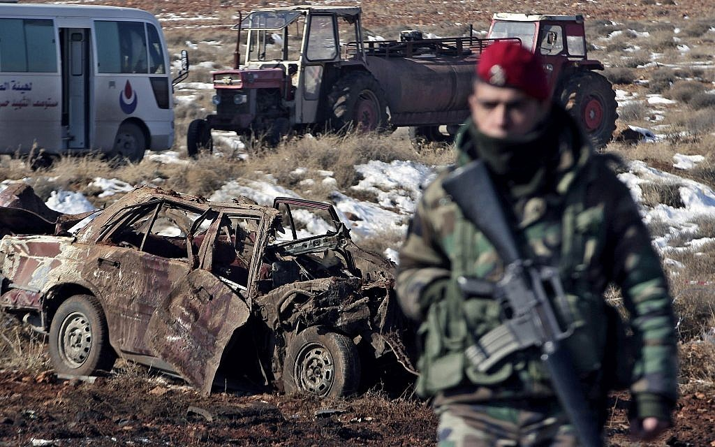 Illustrative: A Lebanese army soldier stands guard at the scene where a car bomb went off near a Hezbollah base near the village of Sbouba in the Baalbek region eastern Lebanon, early Tuesday, Dec. 17, 2013. (AP Photo/Bilal Hussein)