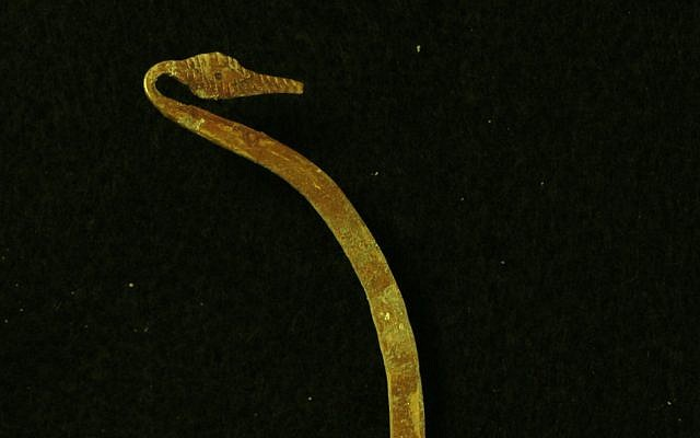 Detail from a gold torque necklace worn by an adult male buried inside the Canaanite tomb discovered at Megiddo. (Adam Prins)