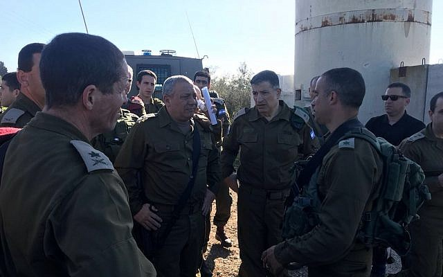 The March 17, 2018 photo shows IDF Chief of Staff Gadi Eisenkot (second from L) visitsing the scene of a car ramming attack in the northern West Bank that killed two soldiers and injured two others along with COGAT head Yoav Mordechai (second from R). (Credit: Israel Defense Forces)
