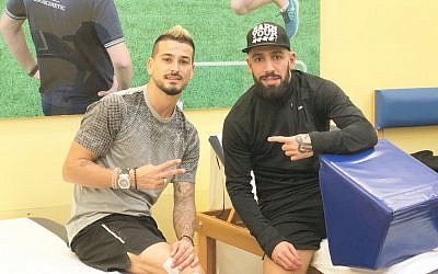 Israeli soccer player Maor Buzaglo (L) posing for a photo alongside Iranian national team captain Ashkan Dejagah on Sunday, March 18, 2018. (Twitter)