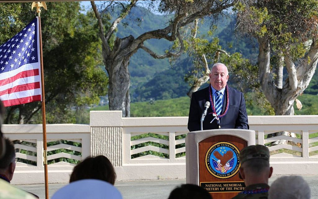 Rabbi Irving Elson, director of JWB Jewish Chaplains Council, a signature program of JCC Association of North America, prays as he addresses guests at a December 13, 2017, ceremony dedicating an interfaith memorial at the National Memorial Cemetery of the Pacific, also known as Punchbowl Cemetery, in Honolulu. The memorial honors chaplains of different faiths who served in the US Armed Forces. (Honolulu Creative Media)