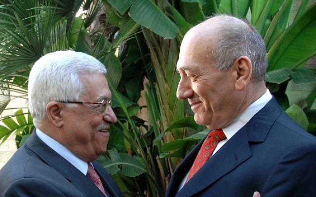 Then-Israeli PM Ehud Olmert meets with Palestinian Authority President Mahmoud Abbas, in Jerusalem, on November 17, 2008. (Moshe Milner GPO/Flash90)