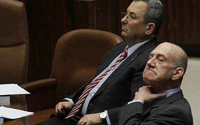 Ehud Olmert, right, and Ehud Barak in the Knesset on March 30, 2009. Miriam Alster/Flash90)
