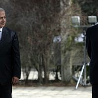 Benjamin Netanyahu (L) and Ehud Olmert at a ceremony marking the transfer of prime ministerial power, at the President's Residence in Jerusalem on April 1, 2009. (Daniel Bar On/Pool/Flash90)