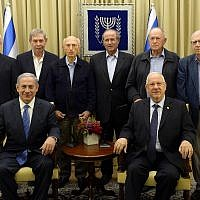 Top row: Former Mossad chiefs from L to R: Danny Yatom, Tamir Pardo, Zvi Zamir, Shabtai Shavit, Nahum Admoni and Efraim Halevy.  Bottom row: Prime Minister Benjamin Netanyahu (L) and President Reuven Rivlin host a candle lighting ceremony for of the Jewish holiday of Hanukkah at the President's residence in Jerusalem on December 18, 2014. (Haim Zach / GPO)