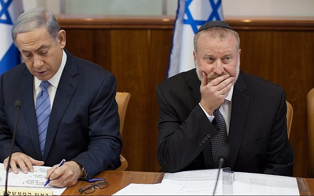 Prime Minister Benjamin Netanyahu (L) and then-cabinet secretary Avichai Mandelblit at the weekly cabinet meeting at the Prime Minister's Office in Jerusalem on July 5, 2015. (Emil Salman/Pool/Flash90)