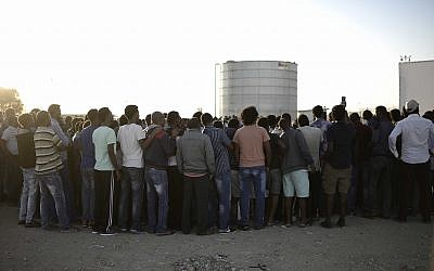 African asylum seekers gather at the entrance to Holot Detention Center on Saturday, June 18, 2016. (Tomer Neuberg/Flash90)