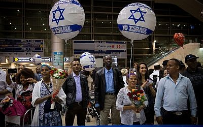 Illustrative: Family members of Ethiopian Jews wait their arrival at Ben Gurion airport, outside of Tel Aviv on June 6, 2017. (Miriam Alster/ Flash90.)