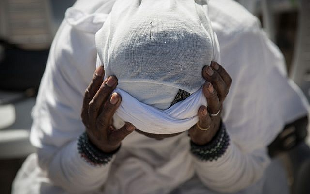 Members of the Ethiopian Jewish community in Israel take part in a prayer of the Sigd holiday on Armon Hanatziv Promenade overlooking Jerusalem on November 16, 2017 (Hadas Parush/Flash90)